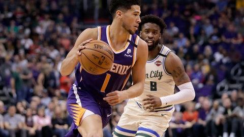 <p>               Phoenix Suns guard Devin Booker (1) drives as Milwaukee Bucks guard Wesley Matthews defends during the first half of an NBA basketball game Sunday, March 8, 2020, in Phoenix. (AP Photo/Matt York)             </p>