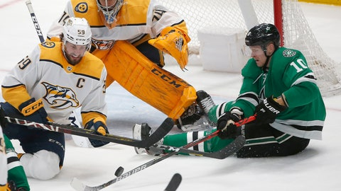 <p>               Nashville Predators defenseman Roman Josi (59) and Dallas Stars right wing Corey Perry (10) battle for the puck as Predators goaltender Juuse Saros (74) looks on during the second period of an NHL hockey game Saturday, March 7, 2020, in Dallas. (AP Photo/Ron Jenkins)             </p>