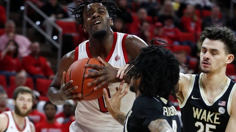 <p>               North Carolina State's D.J. Funderburk (0) keeps the ball from Wake Forest's Sharone Wright Jr. (2) and Ismael Massoud (25) during the first half of an NCAA college basketball game in Raleigh, N.C., Friday, March 6, 2020. (Ethan Hyman/The News & Observer via AP)             </p>