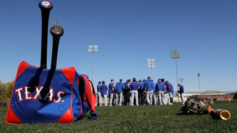 <p>               Texas Rangers position players meet on the mound during spring training baseball workouts Monday, Feb. 17, 2020, in Surprise, Ariz. (AP Photo/Charlie Riedel)             </p>