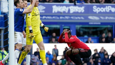 <p>               Manchester United's Odion Ighalo, right, reacts after having a shot at goal stopped by Everton's goalkeeper Jordan Pickford, center, during the English Premier League soccer match between Everton and Manchester United at Goodison Park in Liverpool, England, Sunday, March 1, 2020. (AP Photo/Jon Super)             </p>