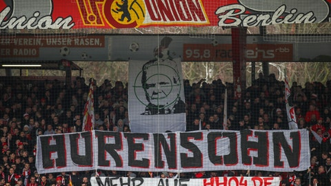 """<p>               Union fans on the tribune display a banner reading """"Son of a bitch"""" against TSG Hoffenheim club patron Dietmar Hopp during the German Bundesliga soccer match between 1. FC Union Berlin and VfL Wolfsburg, in Berlin, Germany, Sunday, March 1, 2020. (Andreas Gora/dpa via AP)             </p>"""