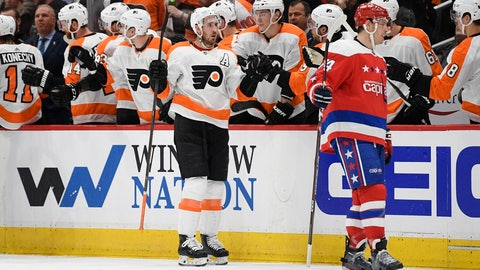 <p>               Philadelphia Flyers center Kevin Hayes, center, celebrates his goal, as Washington Capitals defenseman John Carlson, right, skates nearby during the second period of an NHL hockey game Wednesday, March 4, 2020, in Washington. (AP Photo/Nick Wass)             </p>