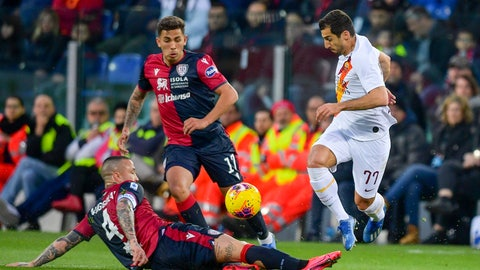 <p>               Roma's Henrikh Mkhitaryan, right, is tackled by Cagliari's Radja Nainggolan, botom center, during the Serie A soccer match between Cagliari and Roma, at the Sardegna Arena stadium in Cagliari, Italy, Sunday, March 1, 2020. (Fabio Rossi/LaPresse via AP)             </p>