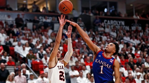 <p>               Texas Tech's Davide Moretti (25) shoots the ball over Kansas' Devon Dotson (1) during the first half of an NCAA college basketball game Saturday, March 7, 2020, in Lubbock, Texas. (AP Photo/Brad Tollefson)             </p>