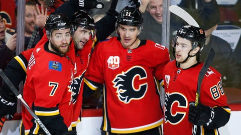 <p>               Calgary Flames' Mikael Backlund (11) celebrates his goal with teammates T. J. Brodie, (7) Mark Giordano, (5) and Andrew Mangiapane (88) during second-period NHL hockey game action against the Arizona Coyotes in Calgary, Alberta, Friday, March 6, 2020. (Jeff McIntosh/The Canadian Press via AP)             </p>