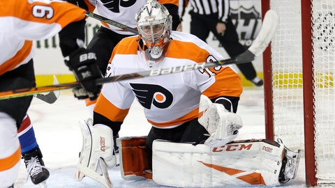 <p>               Philadelphia Flyers goaltender Carter Hart itches the puck during the second period of the NHL hockey game against the New York Rangers, Sunday, March 1, 2020, in New York. (AP Photo/Seth Wenig)             </p>