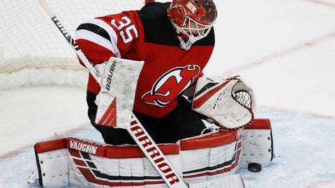 <p>               New Jersey Devils goaltender Cory Schneider makes a save during the third period of an NHL hockey game against the St. Louis Blues, Friday, March 6, 2020, in Newark. (AP Photo/John Minchillo)             </p>