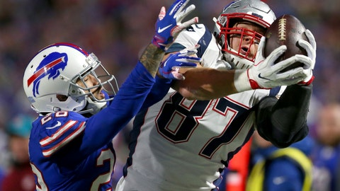 <p>               FILE - In this Oct. 29, 2018, file photo, New England Patriots tight end Rob Gronkowski, right, makes a catch next to Buffalo Bills defensive back Phillip Gaines during the second half of an NFL football game in Orchard Park, N.Y. Gronkowski, the retired Patriots tight end, is set to host WrestleMania in April from WWE's performance center. (AP Photo/Jeffrey T. Barnes, File)             </p>