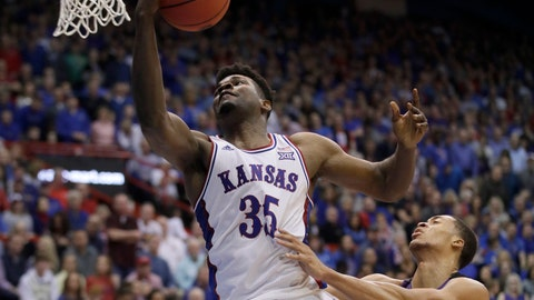 <p>               Kansas center Udoka Azubuike (35) gets past TCU forward Jaedon LeDee, right, for a basket during the first half of an NCAA college basketball game in Lawrence, Kan., Wednesday, March 4, 2020. (AP Photo/Orlin Wagner)             </p>