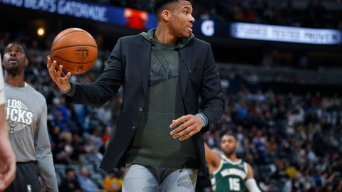 <p>               Milwaukee Bucks forward Giannis Antetokounmpo fields the ball as he shoots with teammates as they warm up for the second half of an NBA basketball game against the Denver Nuggets, Monday, March 9, 2020, in Denver. The Nuggets won 109-95. (AP Photo/David Zalubowski)             </p>