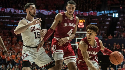 Indiana's Rob Phinisee (10) drives to the basket as teammate Trayce Jackson-Davis (40 blocks Illinois' Giorgi Bezhanishvili (15) in the second half of an NCAA college basketball game Sunday, March 1, 2020, in Champaign, Ill. (AP Photo/Holly Hart)