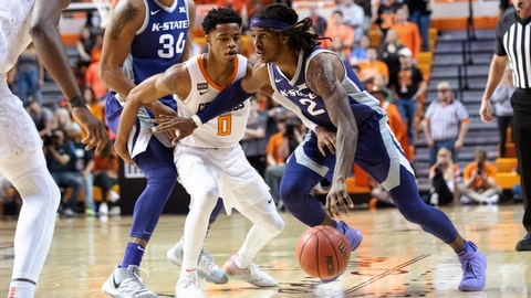 Kansas State guard Cartier Diarra (2) drives the ball past Oklahoma State guard Avery Anderson III (0) during the second half of an NCAA college basketball game in Stillwater, Okla., Wednesday, March 4, 2020. Oklahoma State won 69-63. (AP Photo/Brody Schmidt)