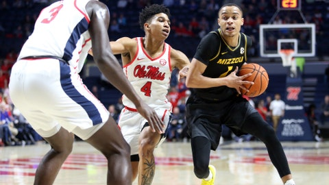 Mar 4, 2020; Oxford, Mississippi, USA; Missouri Tigers guard Xavier Pinson (1) dribbles in the lane as Mississippi Rebels guard Breein Tyree (4) and forward Khadim Sy (3) defend during the first half at The Pavilion at Ole Miss. Mandatory Credit: Petre Thomas-USA TODAY Sports