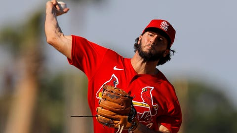 St. Louis Cardinals pitcher Daniel Ponce de Leon throws a pitch to the New York Mets during the seventh inning of a spring training baseball game, Wednesday, March 4, 2020, in Port St. Lucie, Fla. (AP Photo/Julio Cortez)