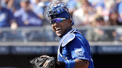 Kansas City Royals catcher Salvador Perez smiles as he turns to a teammate who made an out on a difficult play against the San Diego Padres in the first inning during a spring training baseball game Wednesday, March 4, 2020, in Peoria, Ariz. (AP Photo/Elaine Thompson)