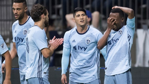 Sporting Kansas City's Gadi Kinda (17) celebrates his goal with teammates Alan Pulido (9) and Graham Zusi (8) during the first half of an MLS soccer match against the Vancouver Canucks in Vancouver, British Columbia, Saturday, Feb. 29, 2020. (Darryl Dyck/The Canadian Press via AP)