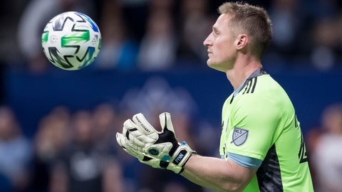 Sporting Kansas City goalkeeper Tim Melia makes a save during the second half of the team's MLS soccer match against the Vancouver Whitecaps in Vancouver, British Columbia, Saturday, Feb. 29, 2020. (Darryl Dyck/The Canadian Press via AP)