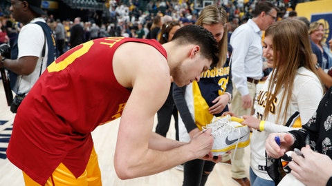 Apr 7, 2019; Indianapolis, IN, USA; Indiana Pacers forward Doug McDermott (20) autographs a pair of shoes for a fan after a game against the Brooklyn Nets at Bankers Life Fieldhouse. Mandatory Credit: Brian Spurlock-USA TODAY Sports