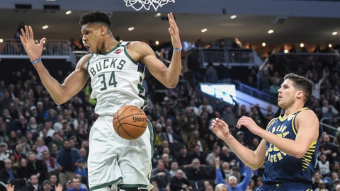 Mar 4, 2020; Milwaukee, Wisconsin, USA;  Milwaukee Bucks forward Giannis Antetokounmpo (34) reacts after dunking against Indiana Pacers forward Doug McDermott (20) in the fourth quarter at Fiserv Forum. Mandatory Credit: Benny Sieu-USA TODAY Sports