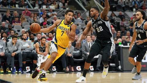 Mar 2, 2020; San Antonio, Texas, USA;  Indiana Pacers guard Malcolm Brogdon (7) drives past San Antonio Spurs forward Rudy Gay (22) in the second half at the AT&T Center. Mandatory Credit: Daniel Dunn-USA TODAY Sports