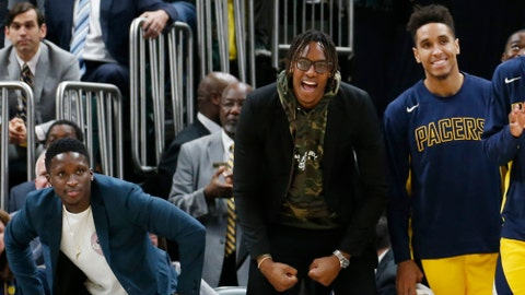 Nov 1, 2019; Indianapolis, IN, USA; From left to right Indiana Pacers guard Victor Oladipo in  and center Myles Turner in street clothes watch from the bench in a game against the Cleveland Cavaliers during the fourth quarter at Bankers Life Fieldhouse. Mandatory Credit: Brian Spurlock-USA TODAY Sports