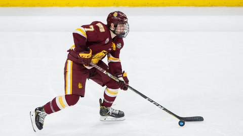 Apr 7, 2018; St. Paul, MN, USA; Minnesota-Duluth Bulldogs defenseman Scott Perunovich (7) skates with the puck in the second period against Notre Dame Fighting Irish in the 2018 Frozen Four college hockey national championship game at Xcel Energy Center. Mandatory Credit: Brad Rempel-USA TODAY Sports