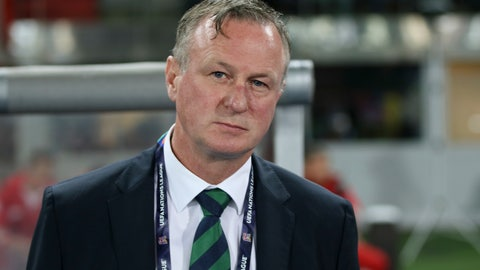 <p>               FILE - In this Friday, Oct. 12, 2018 file photo, Northern Ireland coach Michael O'Neill stands prior to the start of the UEFA Nations League soccer match between Austria and Northern Ireland at Ernst Happel stadium in Vienna, Austria. Northern Ireland coach Michael O'Neill left the job on Wednesday April 22, 2020, citing uncertainty over the team's European Championship playoffs due to the coronavirus pandemic. (AP Photo/Ronald Zak, File)             </p>