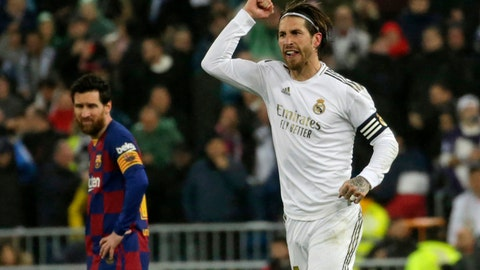 <p>               Real Madrid's Sergio Ramos celebrates as he runs past Barcelona's Lionel Messi during the Spanish La Liga soccer match between Real Madrid and Barcelona at the Santiago Bernabeu stadium in Madrid, Spain, Sunday, March 1, 2020. (AP Photo/Andrea Comas)             </p>