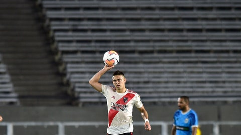 <p>               Rafael Borre of Argentina's River Plate celebrates a goal scored by Milton Casco against Peru's Binacional during a Copa Libertadores Group D soccer match at the Antonio Vespucio Liberti stadium in Buenos Aires, Argentina, Wednesday, March 11, 2020. The game was played in an empty, closed door stadium, as punishment for the violent incidents that happened during the 2018 Libertadores final against town rivals Boca Juniors. (AP Photo/Gustavo Garello)             </p>