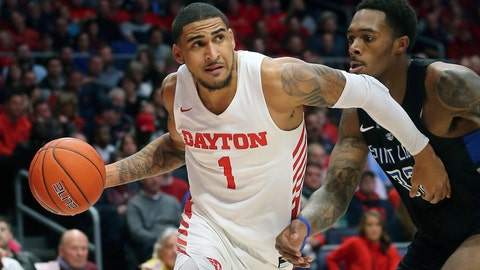 <p>               FILE - In this Feb 1, 2020, file photo, Dayton's Obi Toppin (1) drives to the basket against St. Louis forward Jimmy Bell Jr. (32) during the second half of an NCAA college basketball game in Dayton, Ohio. Toppin was voted the AP men's college basketball player of the year, Tuesday, March 24, 2020.  (AP Photo/Tony Tribble, File)             </p>