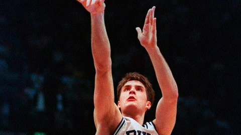 <p>               FILE - In this March 28, 1992, file photo, Duke's Christian Laettner takes the winning shot in overtime over Kentucky's Deron Feldhaus for a 104-103 victory in the East Regional final NCAA college basketball game in Philadelphia. A panel of Associated Press sports writers voted in March 2020 on the top 10 men's basketball games in the history of the NCAA Tournament. They are being republished because the sport has been shut down because of the coronavirus pandemic. The Duke vs Kentucky game on March 28, 1992, was voted No. 2. (AP Photo/Charles Arbogast, File)             </p>