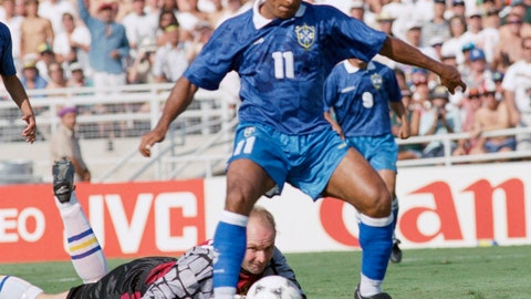 <p>               FILE - In this file photo dated July 13, 1994, Swedish goalie Thomas Ravelli watches Brazilian forward Romario dribble past him as Romario shoots at the goal during the World Cup soccer championship semifinal, Sweden vs. Brazil at the Rose Bowl in Pasadena, USA. The kick was saved on the line by Swedish defender Patrick Andersson (not in picture).  The extrovert Sweden goalkeeper Ravelli who helped give the Scandinavian nation one of its greatest sporting rushes when the Sweden team reached the semifinals of the 1994 World Cup in the United States, and Sweden's national TV broadcaster plans Friday April 10, 2020, to replay the team's games over the coming weeks in an attempt to unite the nation during the coronavirus pandemic. (AP Photo/Thomas Kienzle, FILE)             </p>