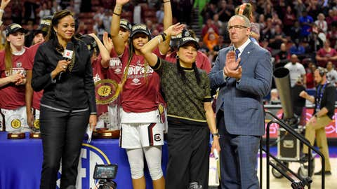<p>               South Carolina head coach Dawn Staley, center right, and Tyasha Harris, center left, acknowledge the crowd after defeating Mississippi State in a championship match at the Southeastern Conference women's NCAA college basketball tournament in Greenville, S.C., Sunday, March 8, 2020. (AP Photo/Richard Shiro)             </p>
