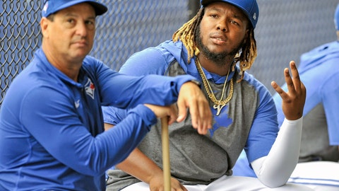 <p>               Toronto Blue Jays manager Charlie Montoyo, left, and infielder Vladimir Guerrero Jr. sit outside the batting cages during full squad workouts at the team's spring training baseball complex in Dunedin, Fla., Wednesday, Feb. 19, 2020. (Steve Nesius/The Canadian Press via AP)             </p>