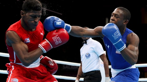 <p>               FILE - In this Aug. 2, 2019, file photo, Keyshawn Davis, right, of the United States, hits Andy Cruz, of Cuba, during their men's light welterweight final boxing bout at the Pan American Games in Lima, Peru. When the Tokyo Olympics were postponed, Davis took several weeks to choose his path to boxing stardom. Every member of the U.S. boxing team agrees so far. Even with an extra year to wait, Davis and his 12 teammates are all still focused on Tokyo and the rewards of the Olympic experience. (AP Photo/Martin Mejia, File)             </p>