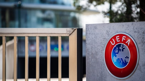 <p>               The UEFA logo displayed to the entrance of the UEFA Headquarters, in Nyon, Switzerland, Tuesday, March 17, 2020. The UEFA meet on 17 March 2020 to discuss the effects of the coronavirus pandemic on the UEFA EURO 2020 and the European Cup competitions. For most people, the new coronavirus causes only mild or moderate symptoms, such as fever and cough. For some, especially older adults and people with existing health problems, it can cause more severe illness, including pneumonia. (Jean-Christophe Bott/Keystone via AP)             </p>