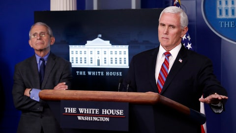 <p>               Dr. Anthony Fauci, director of the National Institute of Allergy and Infectious Diseases, listens as Vice President Mike Pence speaks about the coronavirus in the James Brady Press Briefing Room at the White House, Monday, April 13, 2020, in Washington. (AP Photo/Alex Brandon)             </p>