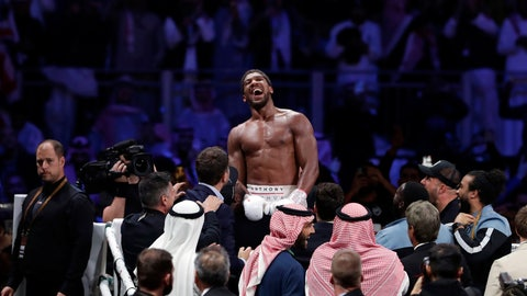 <p>               FILE - In this Sunday, Dec. 8, 2020 file photo, Britain's Anthony Joshua celebrates after beating Andy Ruiz Jr. to win their World Heavyweight Championship contest at the Diriyah Arena, Riyadh, Saudi Arabia. Joshua's first fight as the restored world heavyweight champion could take place in front of no fans. British boxing's governing body has told promoters it hopes to be able to have shows back from July, 2020 after months of inactivity because of the coronavirus outbreak.  (AP Photo/Hassan Ammar, File)             </p>