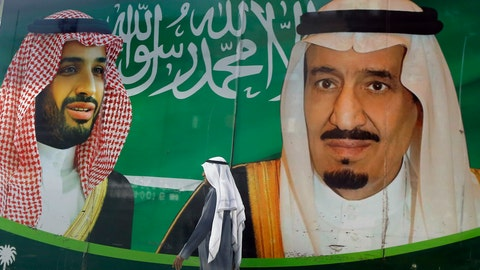 <p>               A man walks past a banner showing Saudi King Salman, right, and his Crown Prince Mohammed bin Salman, outside a mall in Jiddah, Saudi Arabia, Saturday, March 7, 2020. (AP Photo/Amr Nabil)             </p>