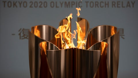 """<p>               FILE - In this March 24, 2020, file photo, the Olympic Flame burns during a ceremony in Fukushima City, Japan. The Olympic flame is going to be on display until the end of April in Japan's northeastern prefecture of Fukushima. Tokyo Olympic and prefecture officials held an official """"handover ceremony""""on Wednesday, April 1, at the J-Village National Training Center in Fukushima.(AP Photo/Jae C. Hong, File)             </p>"""