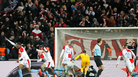 <p>               In this file photo taken on Thursday, March 14, 2019, Slavia's Ibrahim-Benjamin Traore, left, celebrates scoring the decisive goal during their Europa League Round of 16 second leg soccer match between Slavia Praha and Sevilla in Prague, Czech Republic. The top two soccer leagues in the Czech Republic are set to restart on May 25, 2020, as the country's has been easing its restrictive measures adopted by the government to contain the coronavirus pandemic. (AP Photo/Petr David Josek, File)             </p>