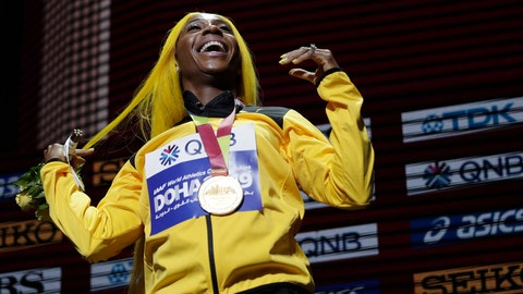 <p>               FILE - In this file photo dated Monday, Sept. 30, 2019, Shelly-Ann Fraser-Pryce of Jamaica, gold medalist in the women's 100 meters, reacts during the medal ceremony at the World Athletics Championships in Doha, Qatar.  Moving from their sports field to the living room, many athletes around the world are doing their bit to boost public health during the coronavirus pandemic lockdown, and one of them is two-time 100-meter champion Shelly-Ann Fraser-Pryce of Jamaica, who is reading her children's book. (AP Photo/Nariman El-Mofty, FILE)             </p>