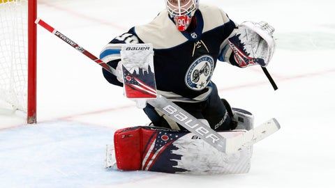 <p>               FILE - In this Feb. 10, 2020, file photo, Columbus Blue Jackets goalie Elvis Merzlikins, of Latvia, makes a stop against the Tampa Bay Lightning during an NHL hockey game in Columbus, Ohio.  The Blue Jackets have signed rookie goaltender Merzlikins to a two-year contract worth a reported $8 million. The 26-year-old Latvian became a fan favorite while successfully filling in for an injured Joonas Korpisalo in the second half of the season. (AP Photo/Paul Vernon, File)             </p>