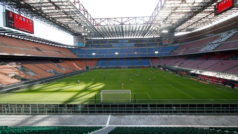 """<p>               FILE - In this Sunday, March 8, 2020 file photo, a view of the empty San Siro stadium during the Serie A soccer match between AC Milan and Genoa, in Milan, Italy. The Italian soccer players' association rejected a proposal from Serie A clubs Monday to reduce salaries by a third if the season does not resume as """"unmanageable."""" The guideline austerity measure was agreed on by 19 of the 20 clubs, the Italian league announced, with Juventus not included because it already finalized a deal with its players to relieve financial pressure on the eight-time defending champion amid the coronavirus pandemic. (AP Photo/Antonio Calanni, File)             </p>"""