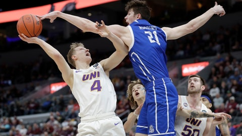 <p>               FILE - In this March 6, 2020, file photo, Northern Iowa's AJ Green (4) has his shot blocked by Drake's Liam Robbins (21) during the second half of an NCAA college basketball game in the quarterfinal round of the Missouri Valley Conference men's tournament in St. Louis. Minnesota has added two accomplished frontcourt players to the roster, bringing in Liam Robbins from Drake and Brandon Johnson from Western Michigan. The Gophers announced the signing of both big men on Wednesday, April 15, 2020. (AP Photo/Jeff Roberson)             </p>