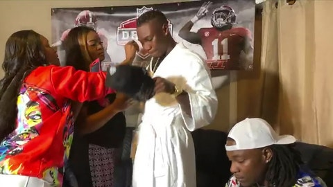 <p>               In this still image from video provided by the NFL, Henry Ruggs III, center, gets ready to put on a Las Vegas Raiders cap after being selected by the team in the first round of the NFL football draft Thursday, April 23, 2020. (NFL via AP)             </p>