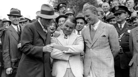 <p>               FILE - In this April 8, 1935, file photo, golfer Gene Sarazen, center, receives a check for $1,500 from sportswriter Grantland Rice, left, for winning the Augusta National Invitation Tournament in Augusta, Ga. Sarazen beat Craig Wood, right, to win the tournament. The Masters wasn't even the Masters in 1935. It was the Augusta National Invitation Tournament, the second edition. Craig Wood was the presumed winner, in the clubhouse at 282, until one shot changed everything. (AP Photo/File)             </p>