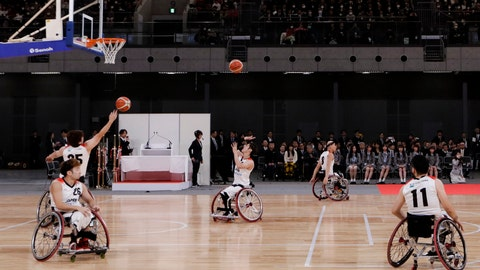 """<p>               FILE - In this Feb. 2, 2020, file photo, members of Japan's national wheelchair basketball team warm up on the court during a grand opening ceremony of the Ariake Arena, a venue for volleyball at the Tokyo 2020 Olympics and wheelchair basketball during the Paralympic Games, in Tokyo. The International Paralympic Committee has """"cash flow"""" problems. But its President Andrew Parsons has ruled out going to the International Olympic Committee for help. (AP Photo/Jae C. Hong, File)             </p>"""