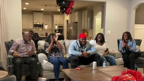 <p>               In this still image from video provided by the NFL, Andrew Thomas, center, smiles during the NFL football draft Thursday, April 23, 2020. The New York Giants selected Thomas with the fourth pick. (NFL via AP)             </p>